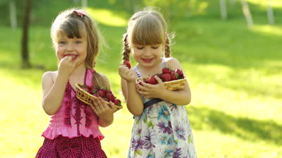 stock-footage-funny-children-girl-eating-strawberries